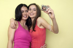 Teenage Girls Using Digital Camera